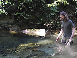 Darren Croft fishing for guppies in Trinidad