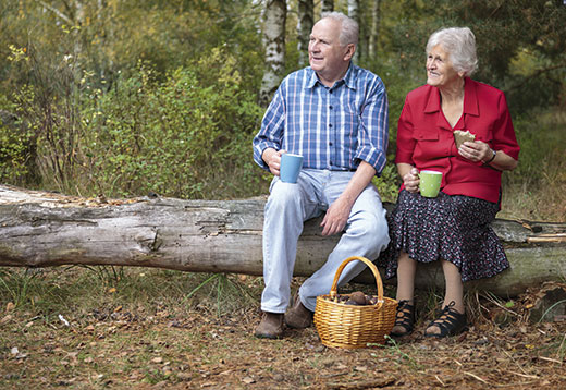 Two older people enjoying the countryside